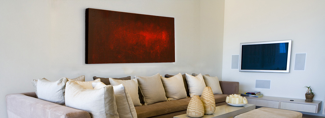 Red abstract painting by Andy Hahn hanging in room