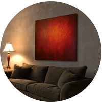 Red abstract painting over couch by Andy Hahn